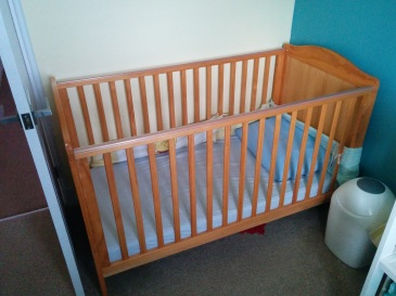 two-height cot suitable for newborn to 18 months